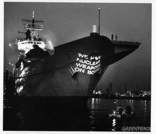 Greenpeace protest against the arrival of the British aircraft carrier ARK ROYAL in Hamburg harbour. The ARK ROYAL carries on board nuclear weapons 80 times the explosive power of Hiroshima. Greenpeace projected 'we have nuclear weapons on board' onto the prow of the ship. Accession #: 1.89.047.001.09
